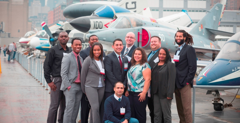 A group of award-winning CUNY students pose on flight deck of the USS Intrepid following the 3rd Annual CUNY Student Veterans' Academic Awards.
