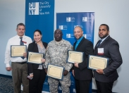 Queensborough CC award-winning students with President Diane B. Call at USS Intrepid Sea Air Space Museum